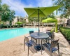 View of Pool Area, Showing Picnic Areas, Cabanas, and Loungers at Stonebriar of Frisco Apartments